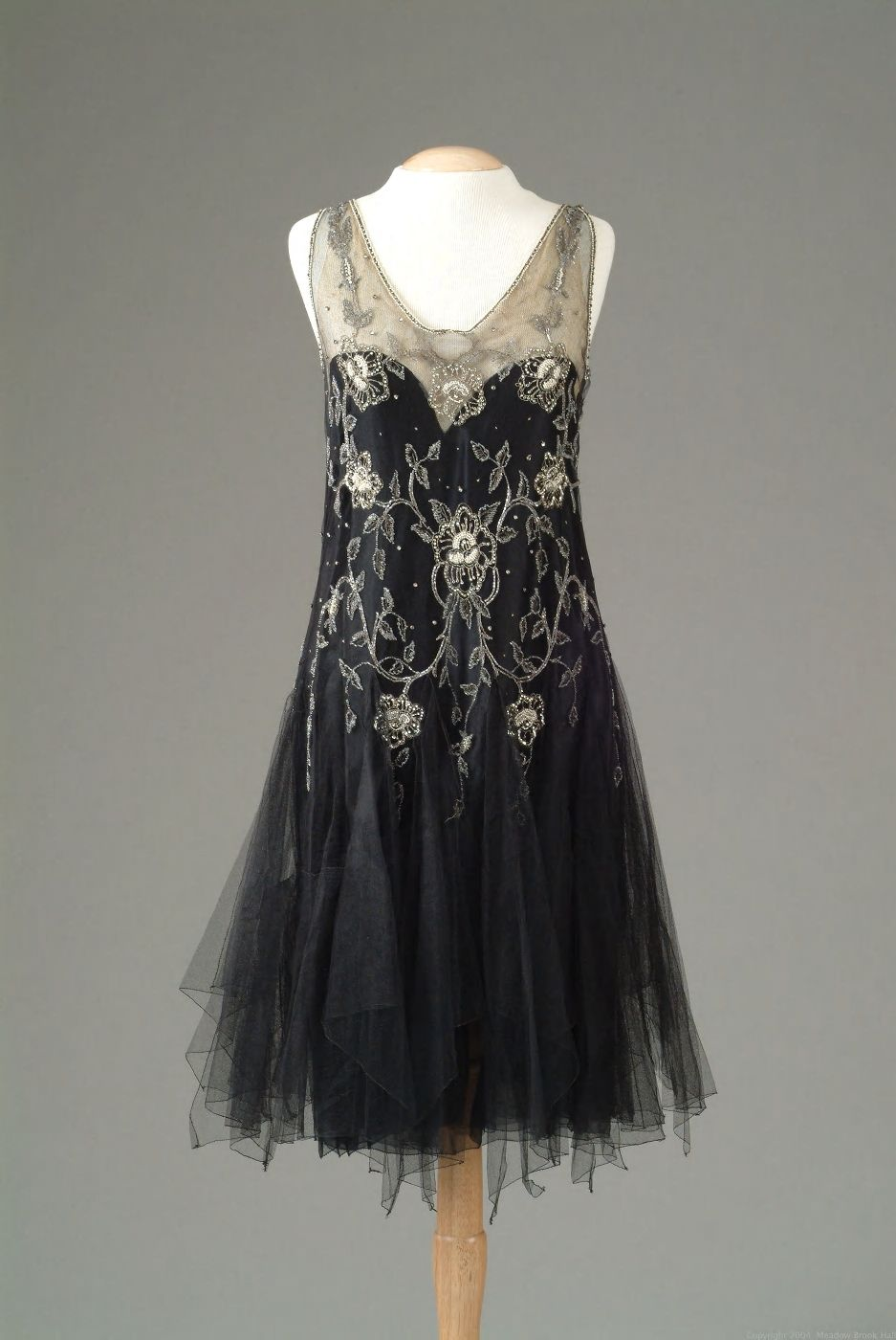 Gown of black netting with seed pearl and rhinestone embroidery in a