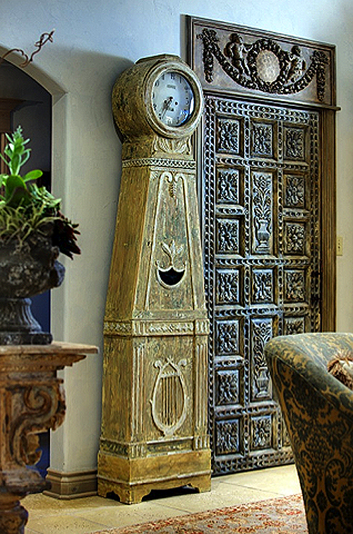 A beautiful carved door from Peru finished with a light gray glaze and highlights of Farrow & Ball Old White paint covers a Coat Closet!     http://swedishdekor.com/_blog/Design_Blog/page/5/#