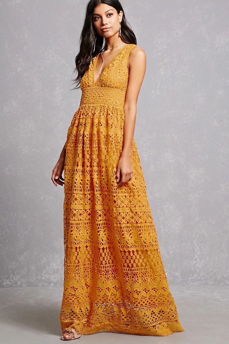 A maxi dress crafted in a crochet overlay featuring a sleeveless