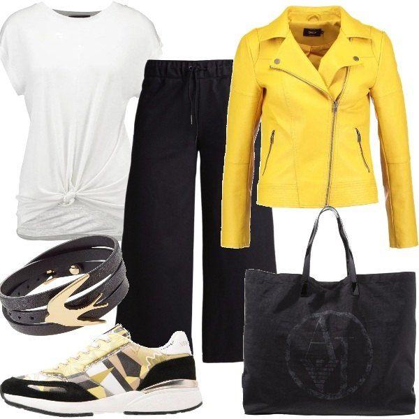 x disco pantalone nero giacca gialla e borsa argento