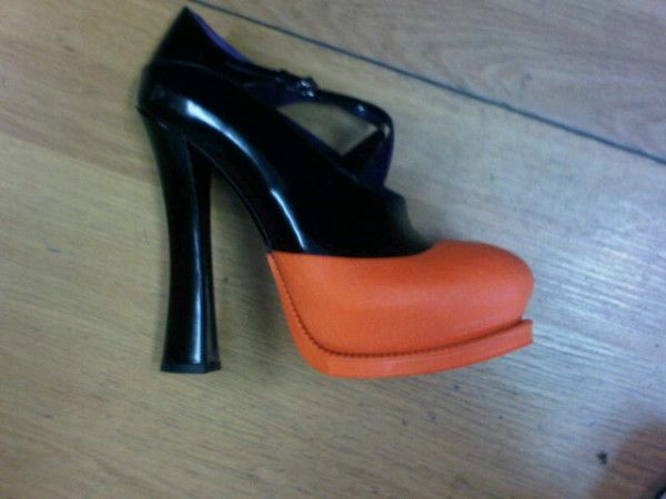must to have   Prada orange rubber dipped shoes from AW12