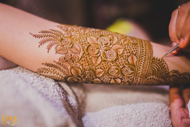 Intricately Patterned Mehndi Design Featuring Roses And Swirls As