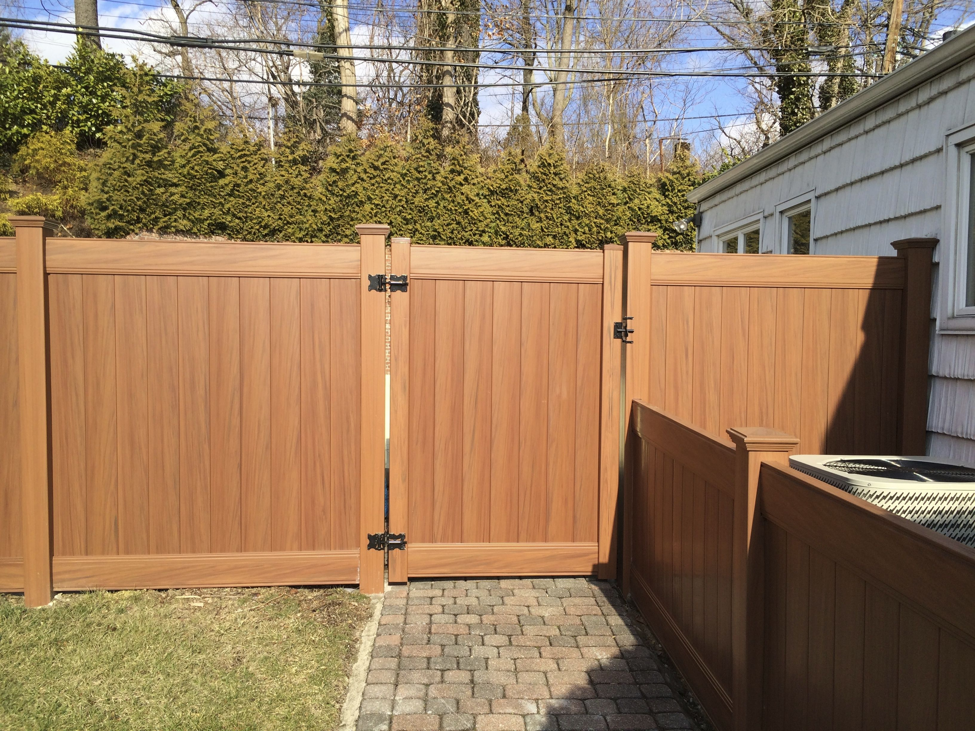 6 ft Infinity Solid woodgrain vinyl fence and gate