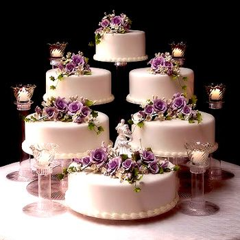 6 Tier Wedding Cake Structure With Purple Roses And Candles