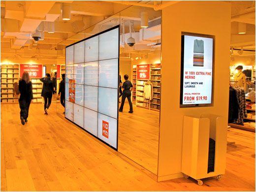 Uniqlo 39 s new york flagship store enhances shopping for Mobiliario oficina diseno