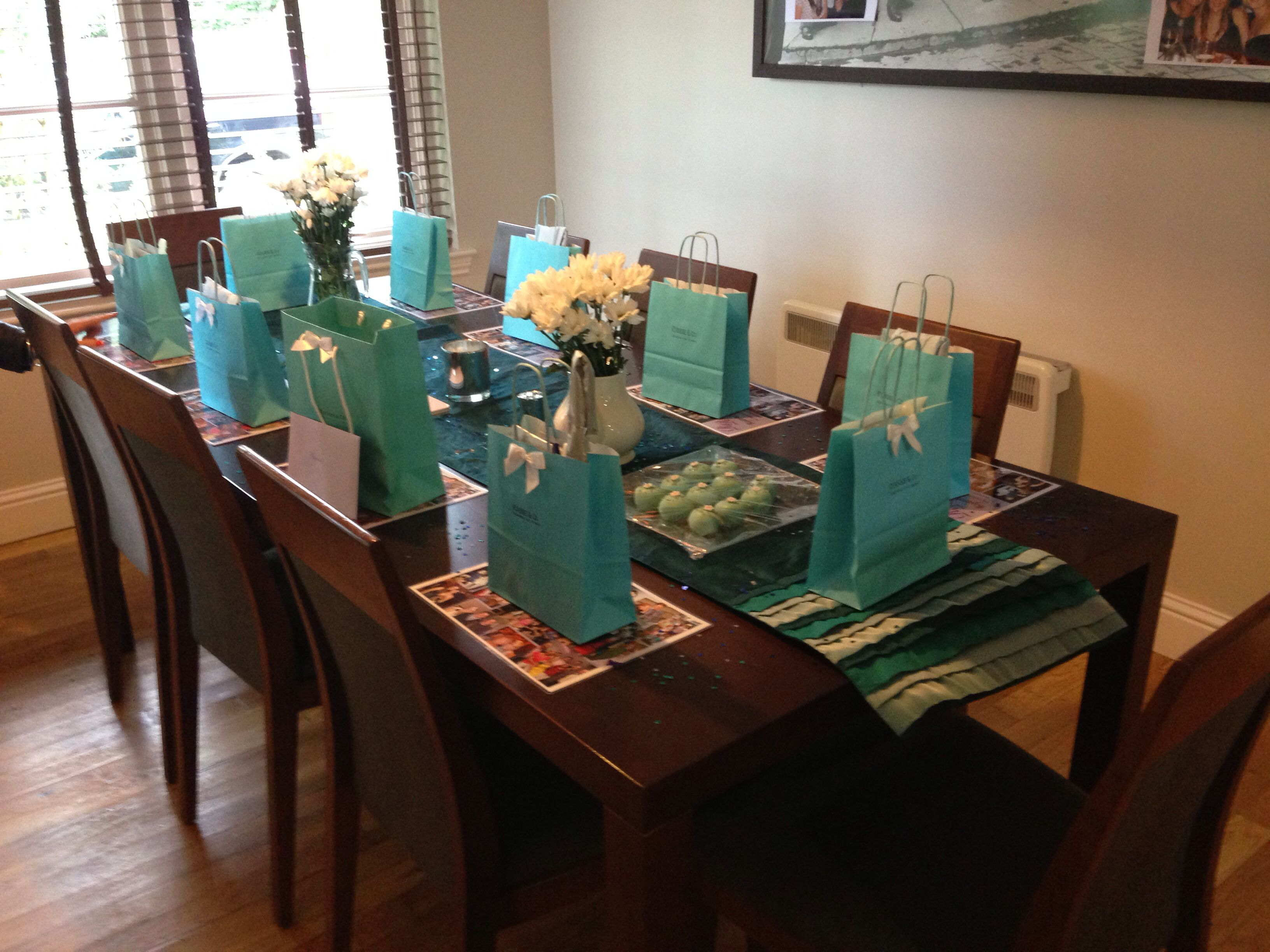Tiffany themed dinner party with gift bags containing black sunglasses, string of costume pearls, costume tiara & long black gloves. All you need to become miss GoLightly,