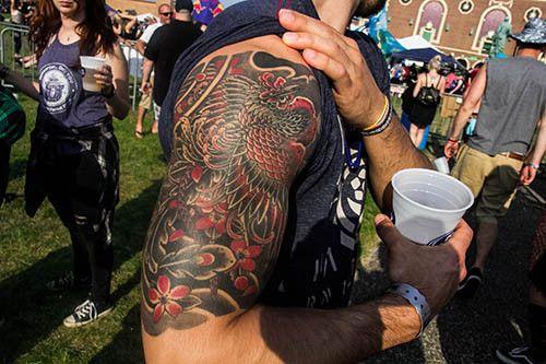 Scott Kent displays his Japanese style half-sleeve.  #InkedMagazine #Japanese #tattoo #tattoos #sleeve