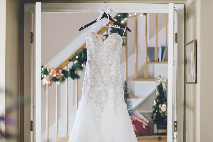 Wedding dress hangs in the foyer for a Westmount Country Club wedding. Captured by Northern NJ wedding photographer Ben Lau.