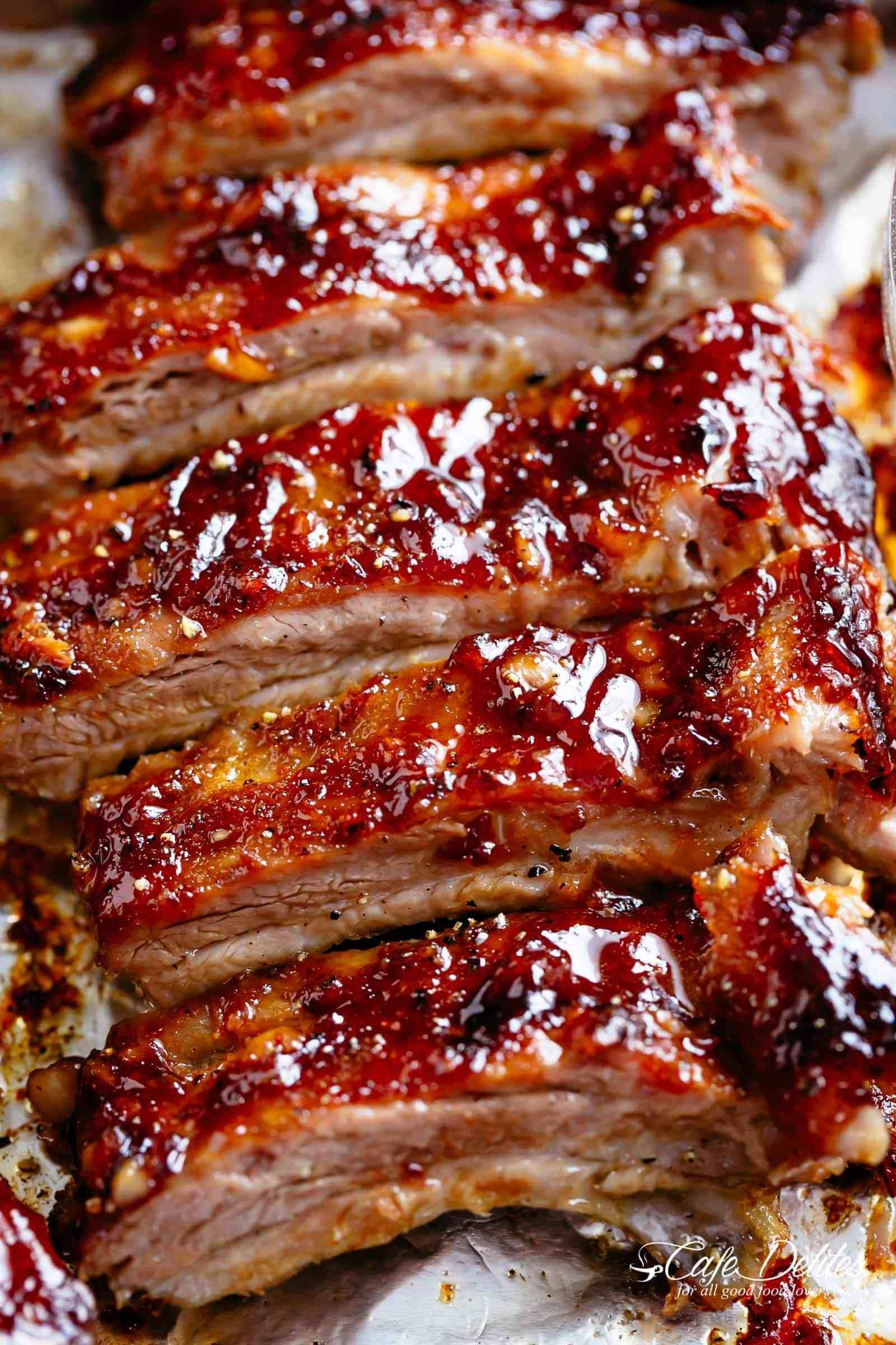 American Ribs Oven Baked And Slathered In The Most Delicious Barbecue Sauce Cafedelites Com Baked Pork Ribs Rib Recipes Ribs Recipe Oven