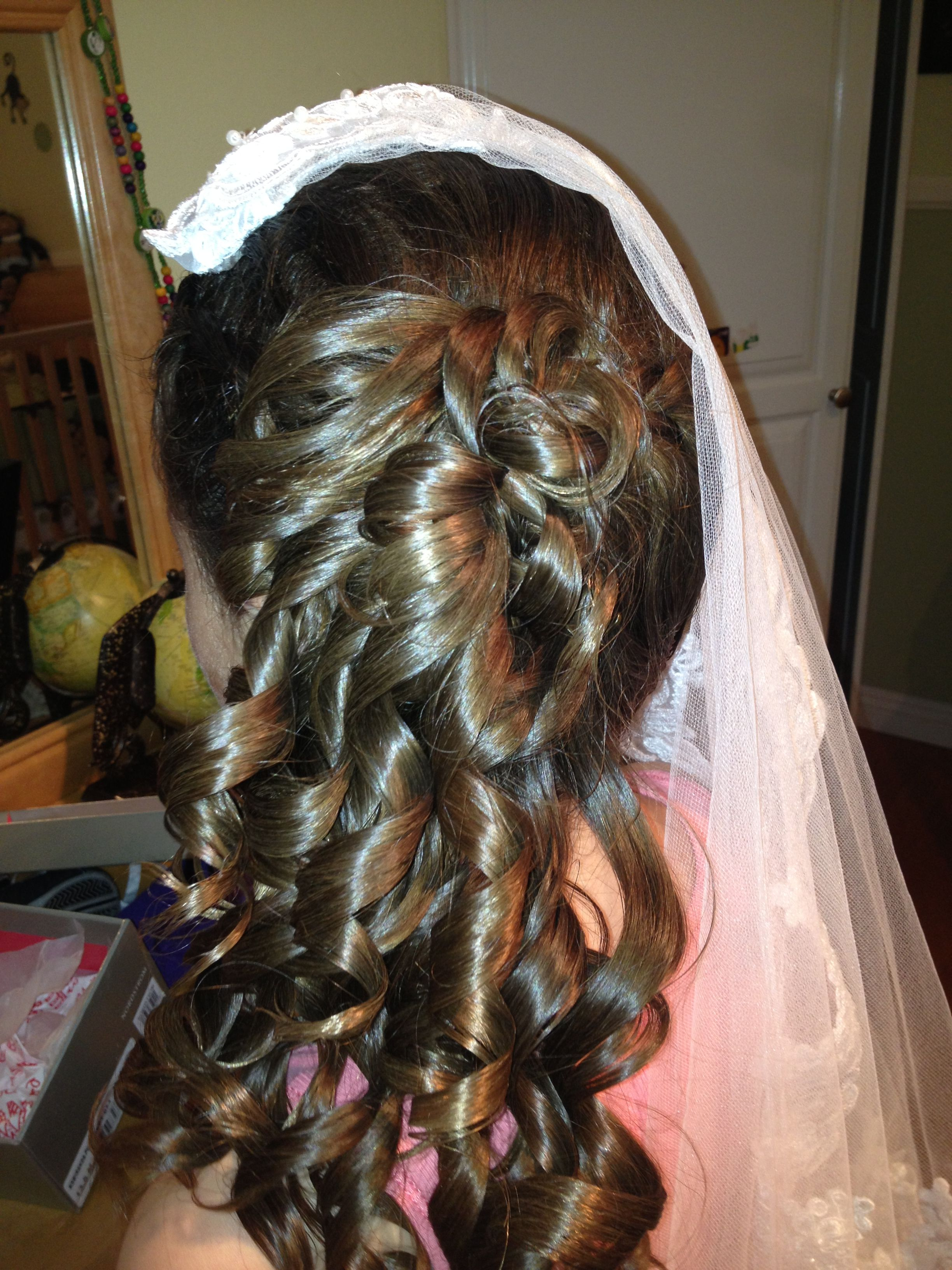 Daniella's hairstyle for her communion.