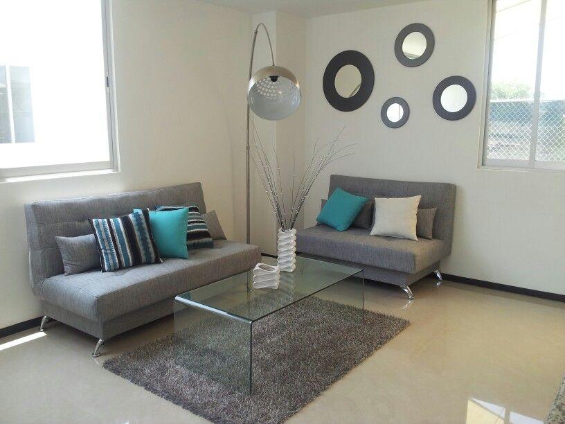 Departamento moderno en gris con turquesa modern for Sala gris con azul