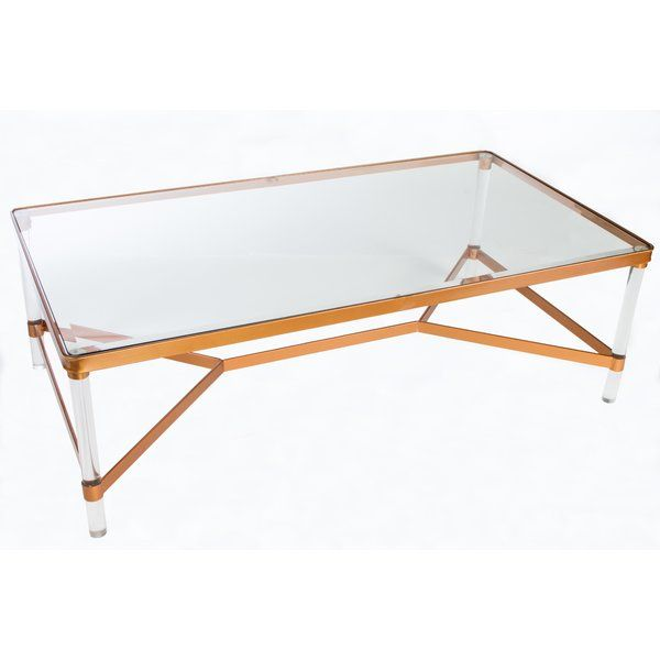 This Modern Coffee Table Has A Glass Top With Acrylic Legs With