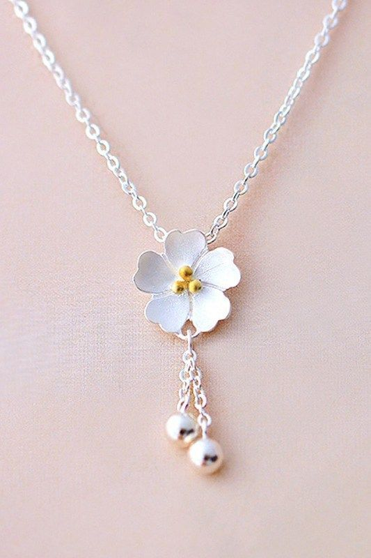 Cute Sterling Silver Sakura Blossom Necklace is part of Wedding jewelry, Jewelry necklaces, Silver jewelry, Jewelry, Fashion jewelry, Beautiful jewelry - Light up your look with this adorable sakura flower necklace  Dangling silver accents add an eyecatching sparkle, and the simple style makes this a necklace that will fit with any lifestyle
