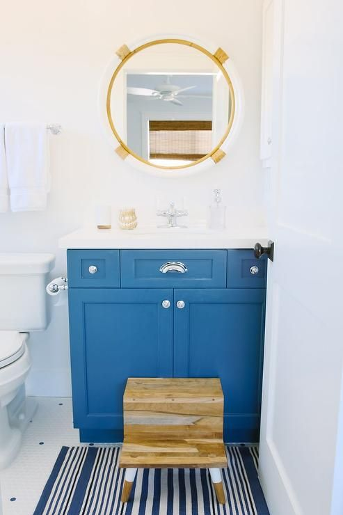 Tan and blue boy bathroom features a serena lily montara mirror over a blue washstand