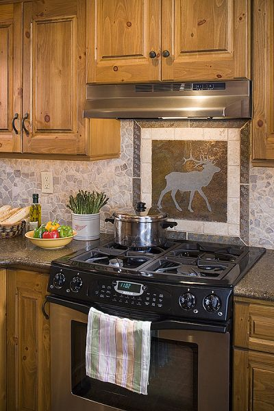 Adore those cabinets tile backsplash of elk i would for Log cabin kitchen backsplash ideas