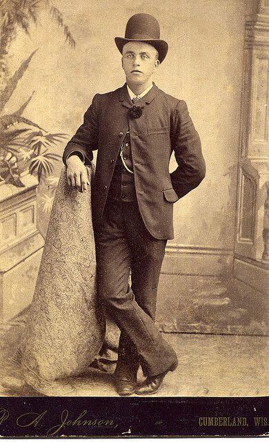 3a214c60f9b A man of the 1880s in a sack suit and bowler hat.