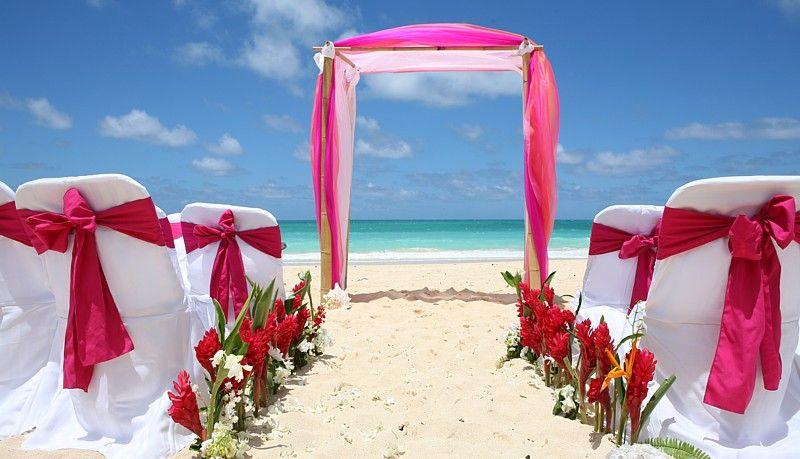 wedding color schemes for april bridesmaids wearing sarong wraps a beach wedding in hawaii