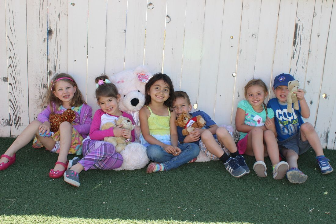 You can tell these kids are loving having their teddy bears visit for the day!