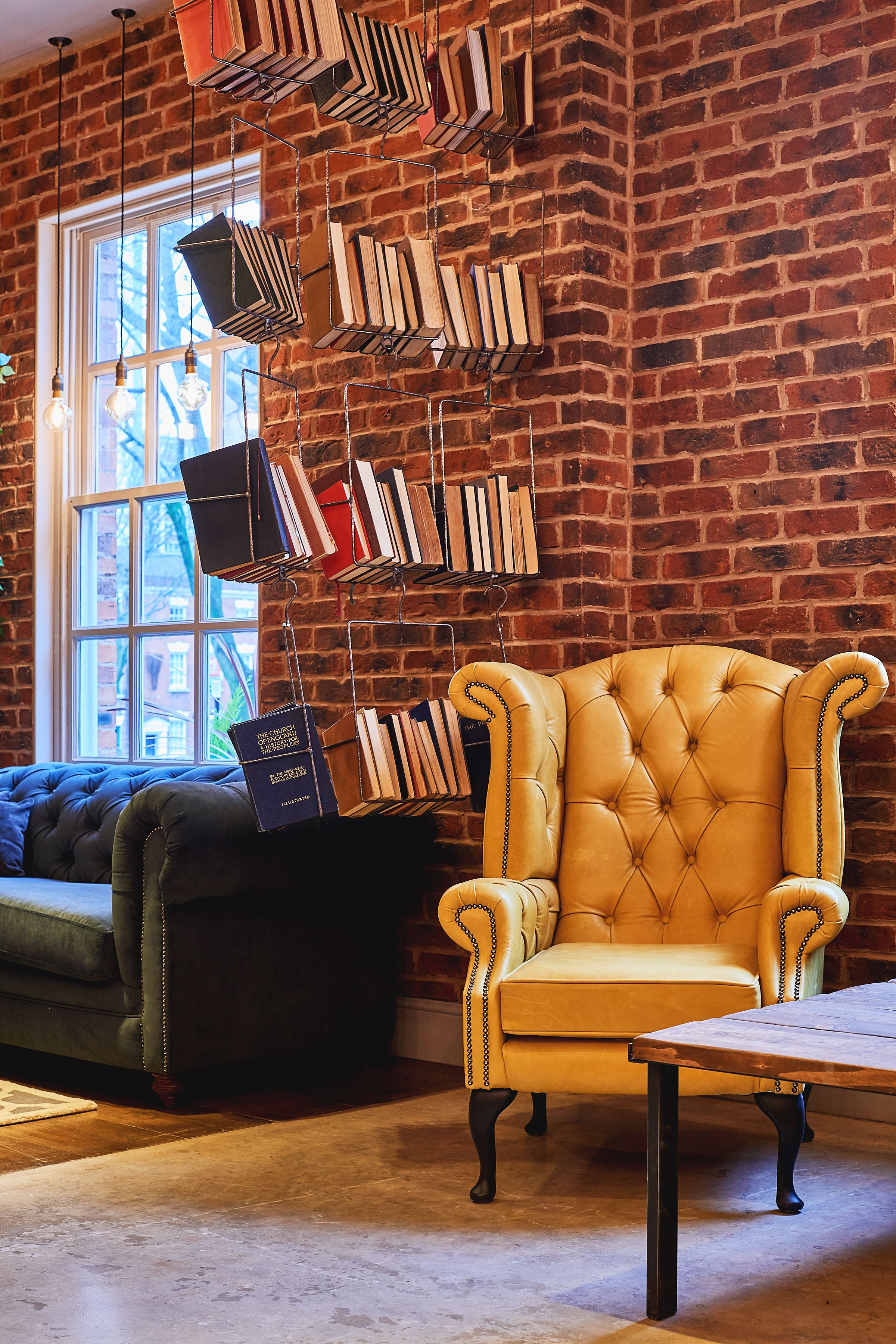Yellow Comfortable Feature Wing Back Chesterfield Chair With Hanging Wire Frame Quirky Book Shelf Ideas