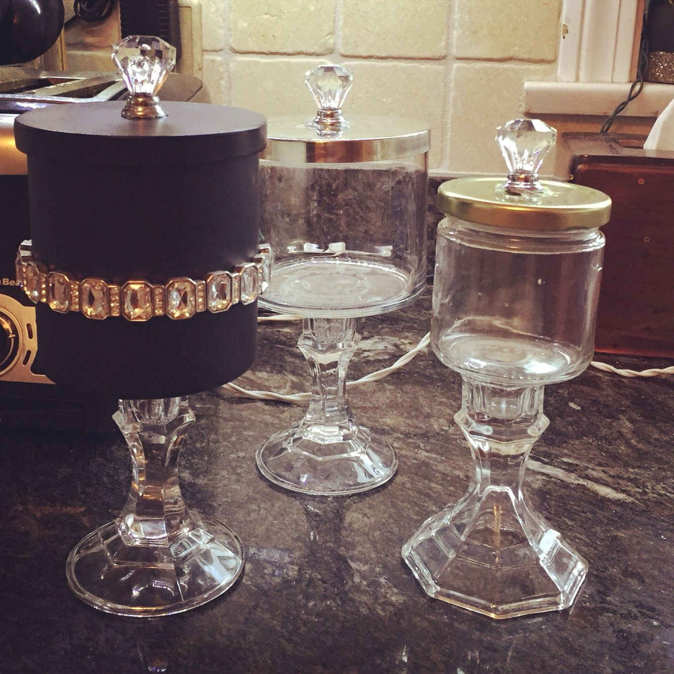 Diy apothecary jars. Empty candle jars. Dollar tree candle sticks and acrylic drawer pulls
