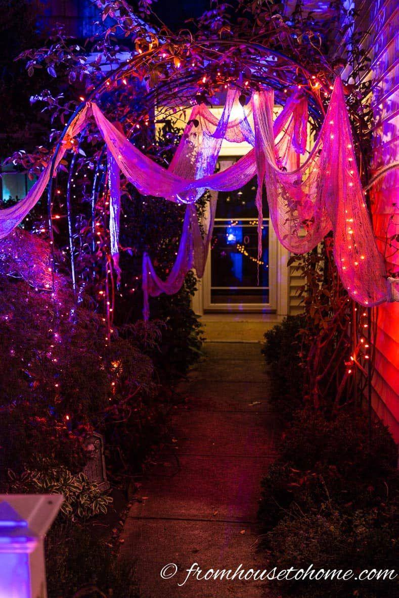 Halloween Outdoor Lighting Ideas 21 Spooky Ways To Light Your Yard Entertaining Diva From House To Home Outdoor Halloween Halloween Yard Halloween Lighting Outdoor