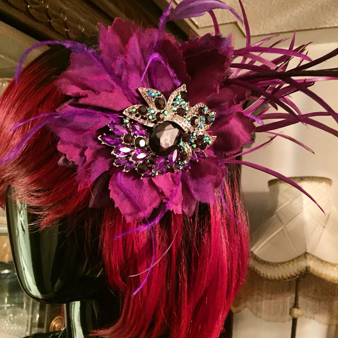 "New item I just did for a customer. Thought I'd share. Could be yours today! Available in all fabulous colors. Go home with yours today. ""Beauty is how you wear it and what's inside you."" #beauty #desireebydesign #hairclip #wine #purple #feathers #handmade #couture #hairaccessories"