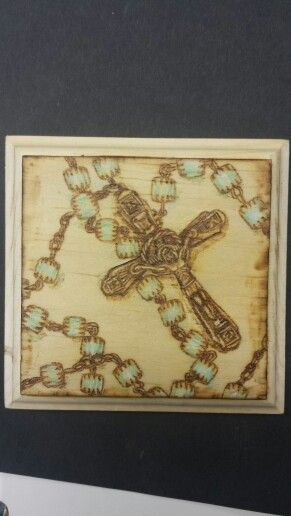 This is an original wood burning that I did of my great grandmother's rosarie beads