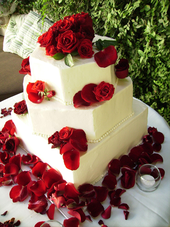 Bright red roses on a white wedding cake wedding cakes pinterest