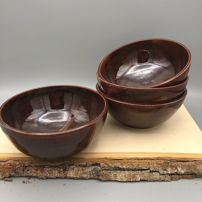 Set of Four Amber Brown Ceramic Bowls #etsy #ceramic #ceramicbowl #wheelthrownbowls #dinnerbowls #handmadebowls #potterybowls #ceramicbowls #setofbowls #ceramics #ceramicdesign #pottery #potterydesign #potteryset #ceramicset #dinnerset #amberbrownglaze #dynamicglaze #subtleglaze