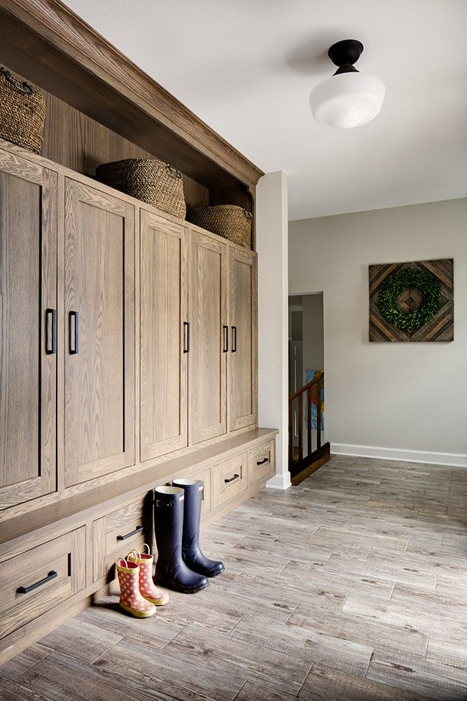 Photo of Stylish natural wood lockers in a mudroom