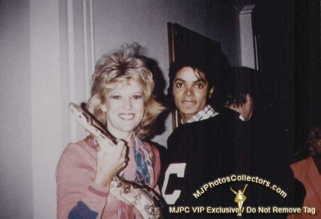 Michael Jackson. Not sure who the lady is but she's holding a snake.