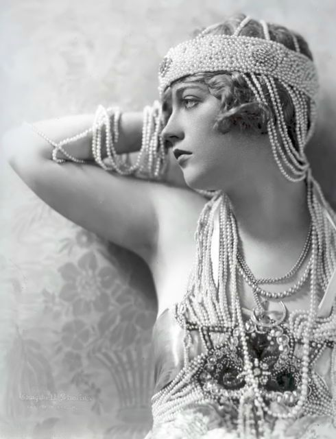 Marion Davies in pearls. An American film actress, producer, screenwriter, and philanthropist, Marion Davies is remembered also as the mistress of William Randolph Hearst.