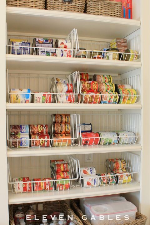 When stored on their sides, cans are stackable yet keep their labels in sight. Of course, you'll need to contain the sideways cans somehow — and these wire baskets are just the right thing for the job. Your organized pantry will thank you.  See more at Eleven Gables »