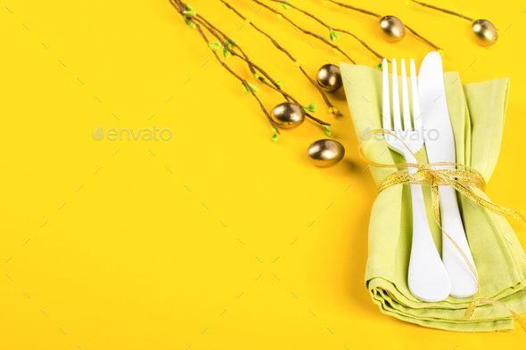 Easter table setting .Happy Easter concept. by prosto_juli. Easter table setting with Kitchen cutlery on a bright yellow background. Holiday decoration.Happy Easter concept. Top...