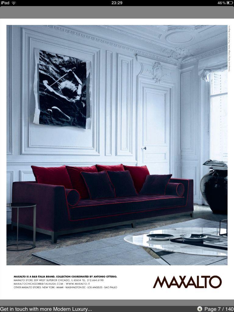 Purple velvet sofa with deep raspberry pillows lush