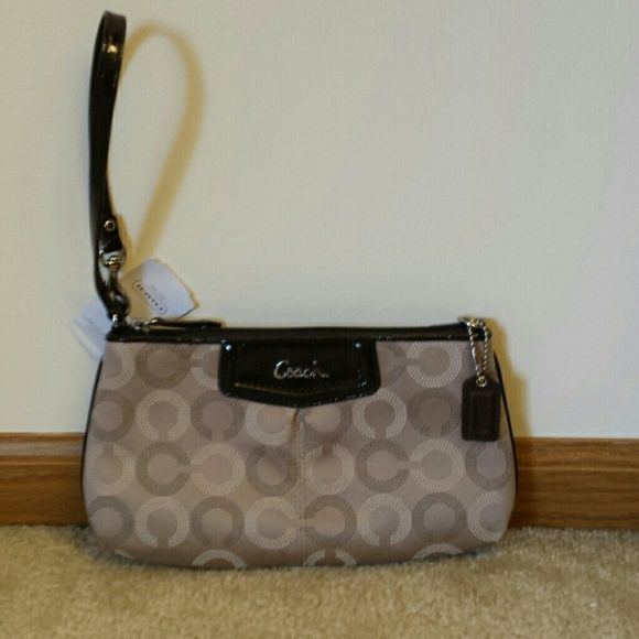 "Coach Genuine Signature large wristlet This Coach wristlet is the perfect fall color! Goes with everything.  Has convertible handle, leather trim and Coach leather hangtag. Inside are 8 credit card pockets and cell phone slip pocket.  Wonderful gift or for your personal use! Size is 9 1/2"" across and 5 1/2"" tall by 1 1/2"" wide. Coach Bags Clutches & Wristlets"