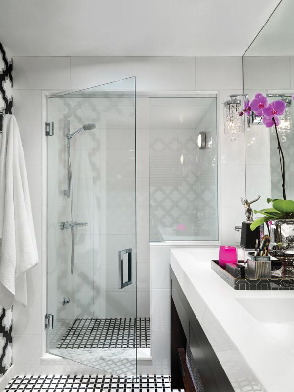 Calgary designer Martine Ast's bold master bathroom is dominated by black and white marble with a touch of colour in the form of orchids #westernliving #martineast #bathroom #marble #radiantorchid