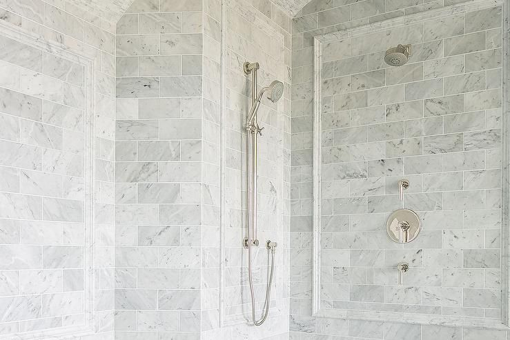 A Chrome Shower Head And Sprayer Are Fixed To Gray Marble Subway Shower Surround Tiles Lined With Gray Marble Cha Marble Shower Walls Chair Rail Walk In Shower
