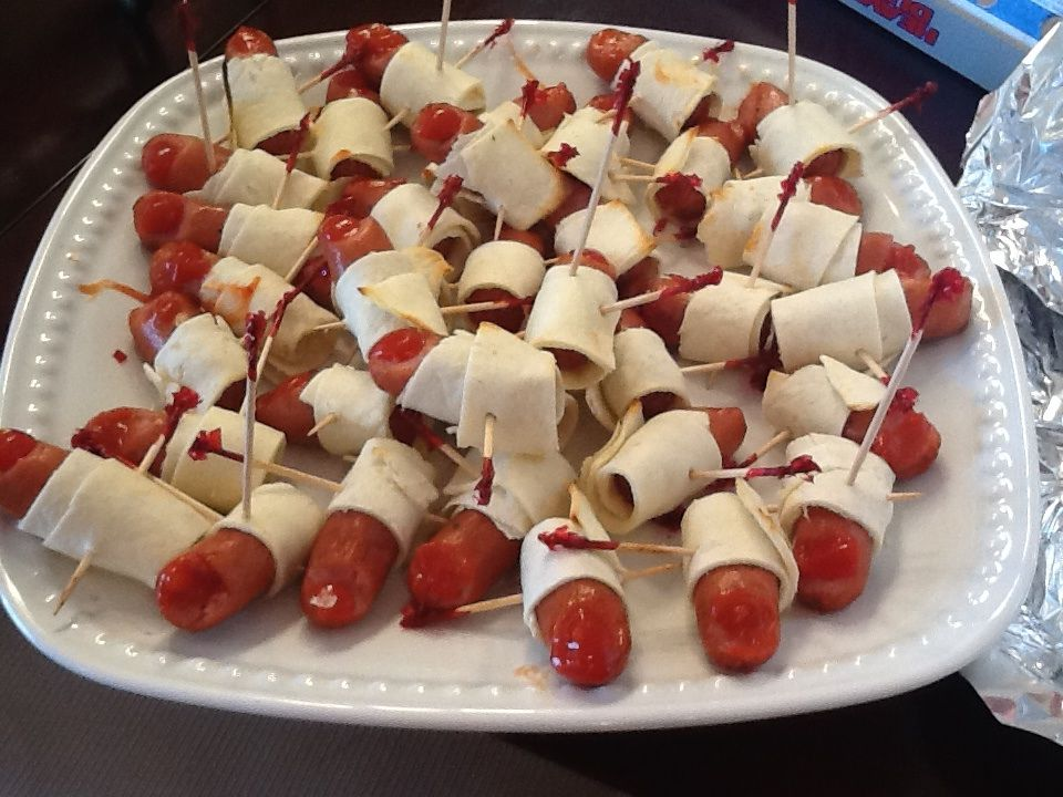Halloween party food, mini hotdogs wrapped with tortilla and ketchup - sweet 16 halloween party ideas