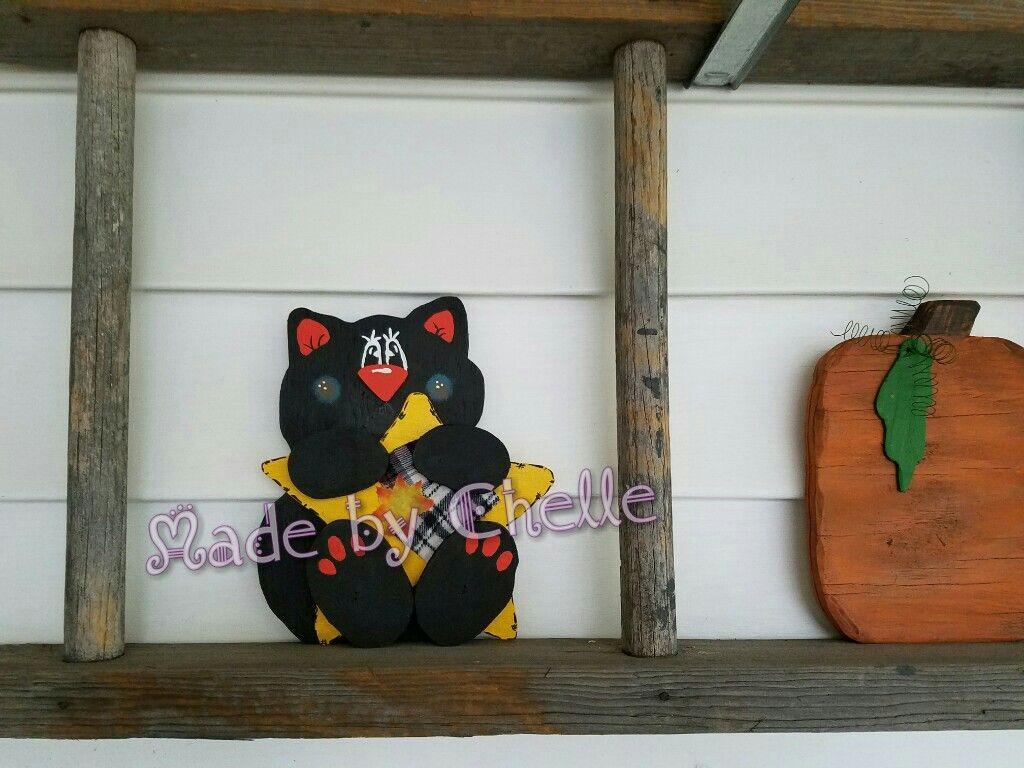 Cute black cat shelf sitter