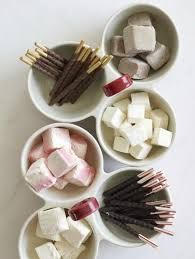 Small bowls of candy such as candy canes, chocolate drops, caramels and sprinkles give your guests a chance to customize their treat.