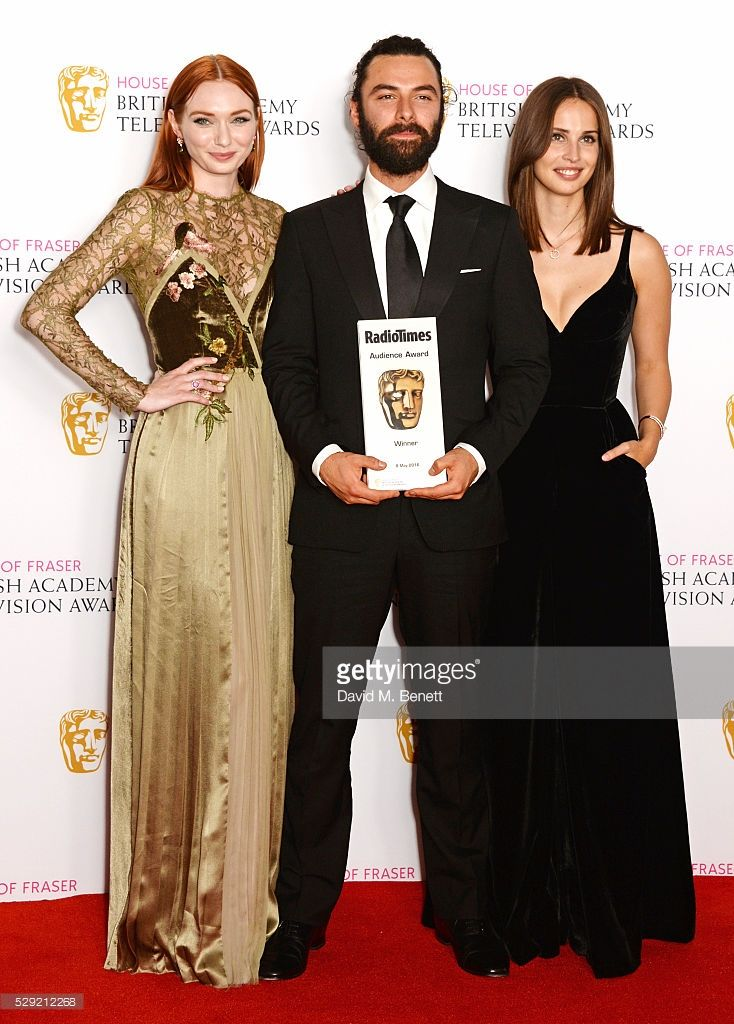 Eleanor Tomlinson, Aidan Turner and Heida Reed, accepting the Radio Times BAFTA Audience Award for 'Poldark', pose in the winners room at the House Of Fraser British Academy Television Awards 2016 at the Royal Festival Hall on May 8, 2016 in London, England.