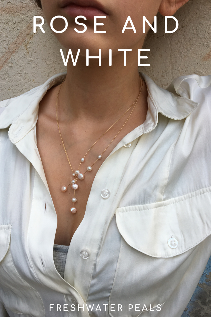 Rose and white freshwater pearls on a gold wire 26.78 €