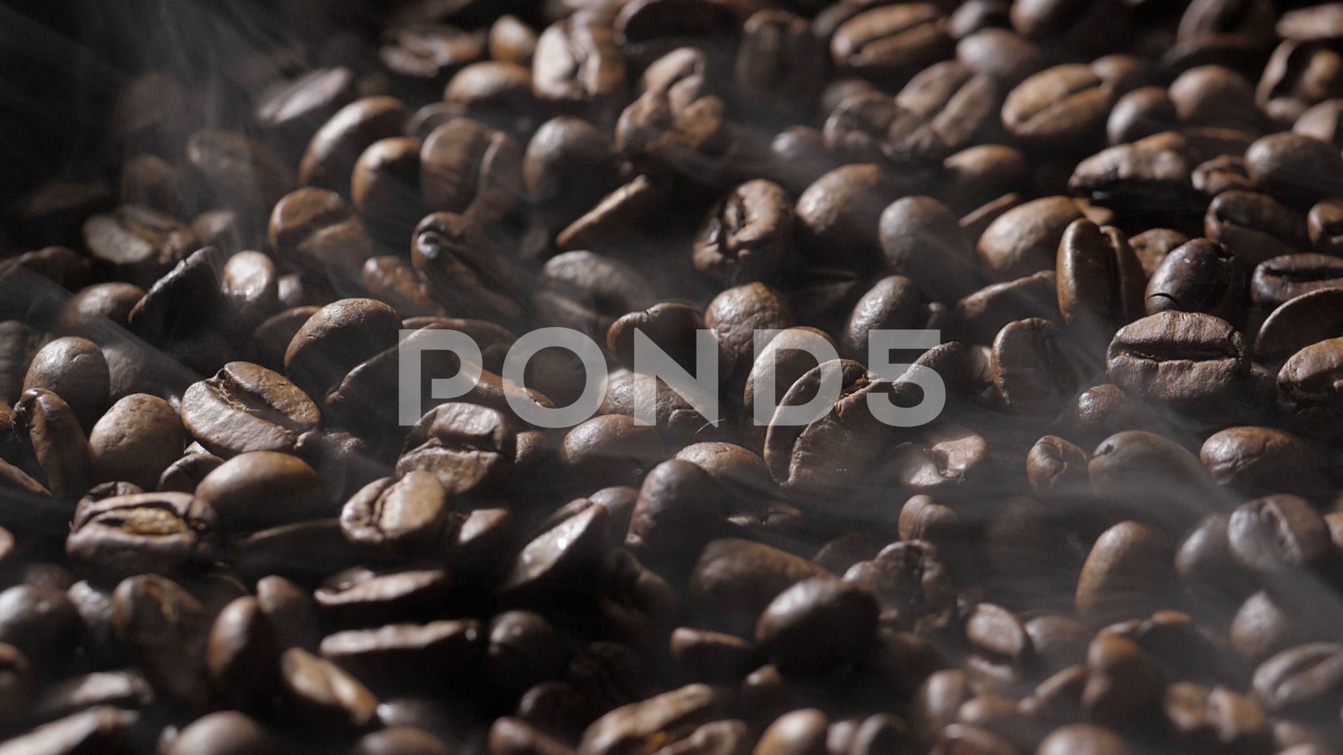 Coffee Beans Rotate While Roasting Smoke Comes From Coffee Beans