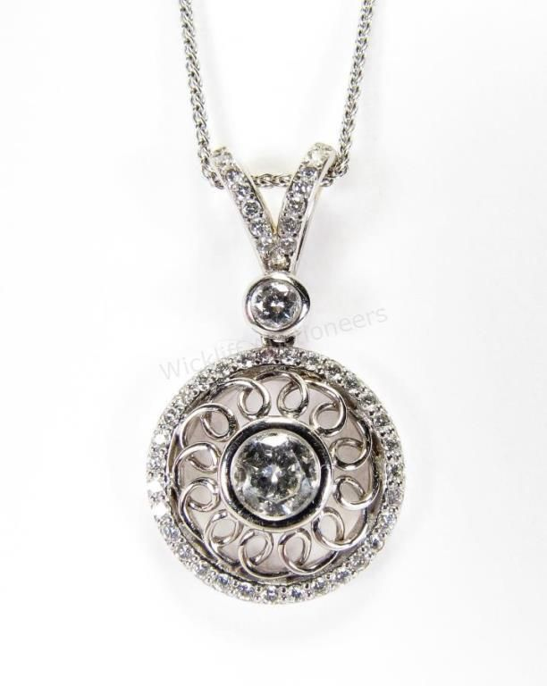 18K white gold round pendant with approximately .55ct round brilliant cut center diamond with accent diamonds #pendant #diamonds #wickliffauction