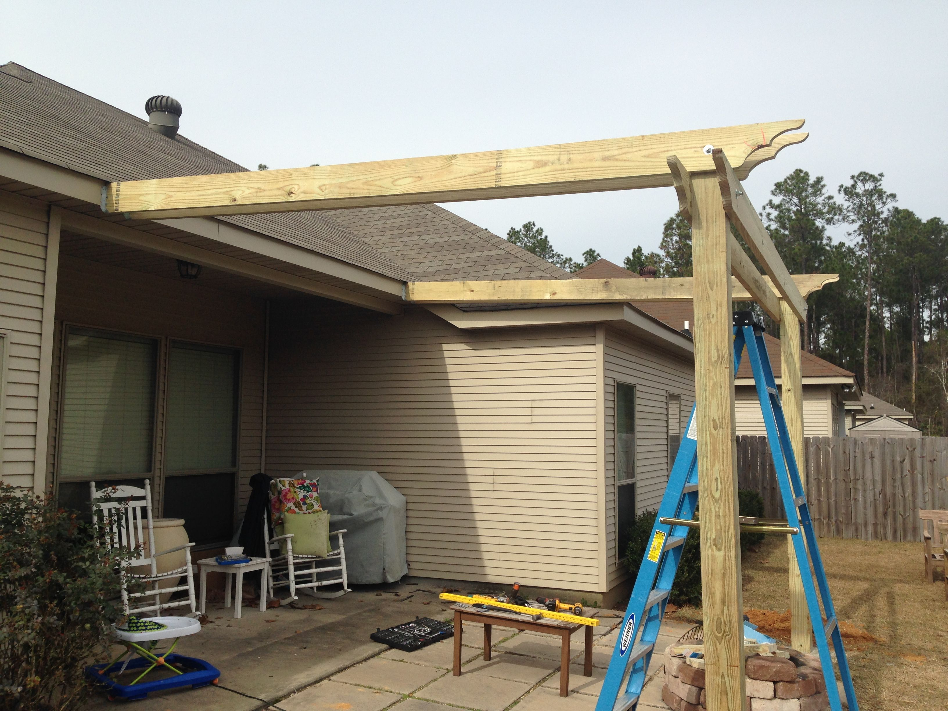 build patio roof attached to house