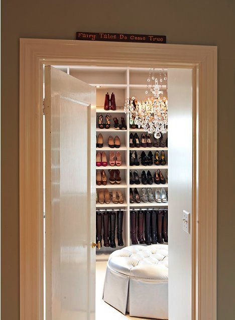 closet with chandelier and ottoman...for when we redo our very cramped closet!