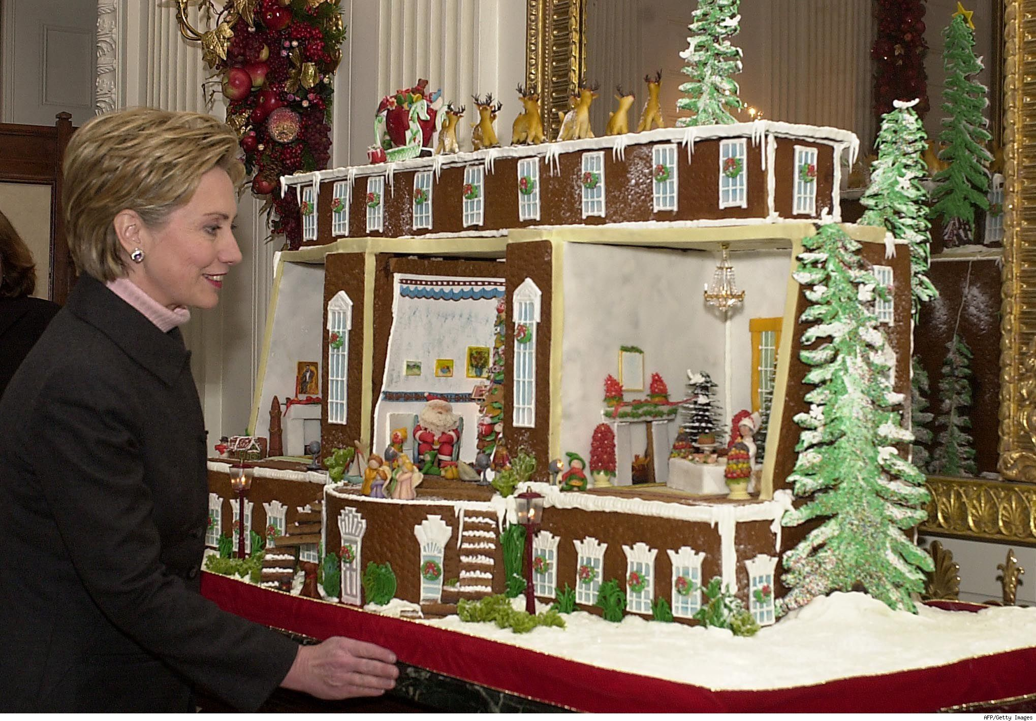 Here U S First Lady Hillary Clinton admires the gingerbread house