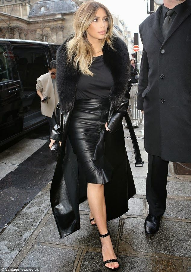 in a floor length leather skirt and leather
