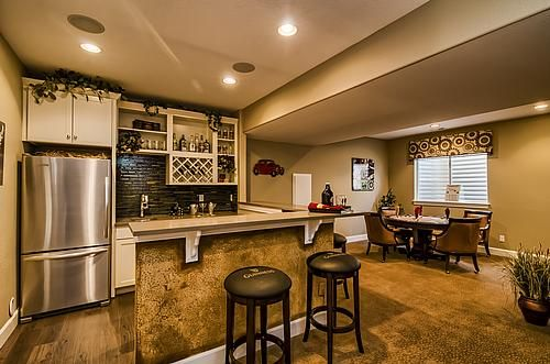 Complete Wet Bar With A Full Size Fridge And A Poker Table Note